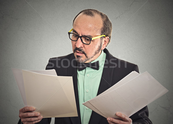 Confused businessman looking at documents Stock photo © ichiosea