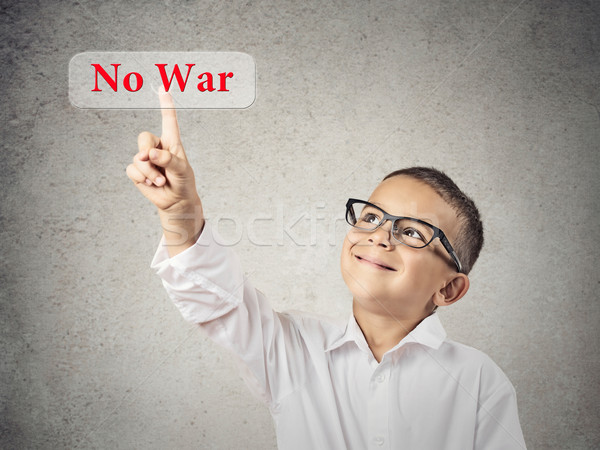 Boy Clicks on No War Button Stock photo © ichiosea