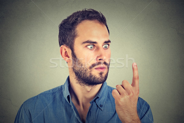 Stock photo: Shocked man looking at his finger
