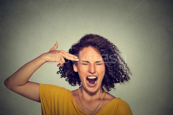 женщину самоубийства пальца пушки жест Сток-фото © ichiosea