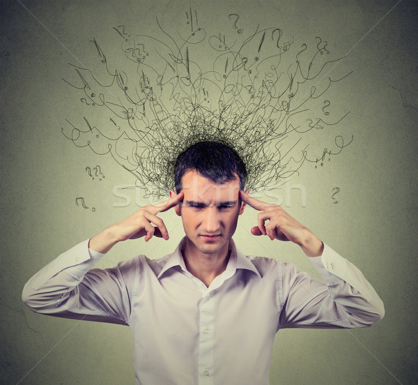 sad young man with worried stressed face expression and brain melting into lines  Stock photo © ichiosea