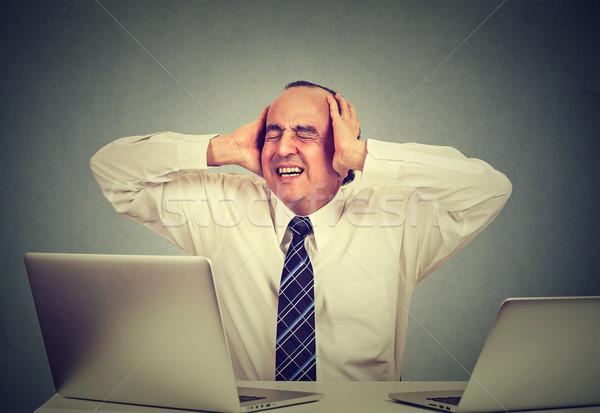 Középkorú férfi stressz kettő laptopok dolgozik iroda Stock fotó © ichiosea