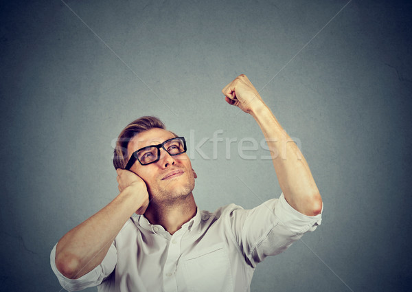 young man covering his ears from loud noise, having headache Stock photo © ichiosea