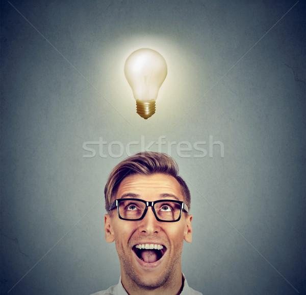 Heureux homme verres lumineuses lumière Photo stock © ichiosea