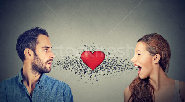 Love connection. Man woman talking to each other red heart in-between  Stock photo © ichiosea