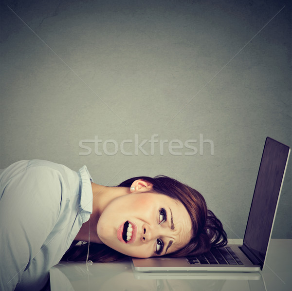 Desperate employee stressed woman resting head on laptop keyboard Stock photo © ichiosea