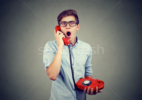 Shocked man receiving bad news on the phone  Stock photo © ichiosea