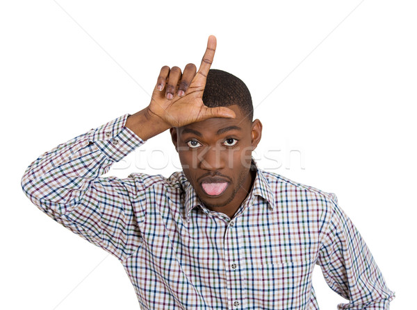 funny young man displaying loser sign Stock photo © ichiosea