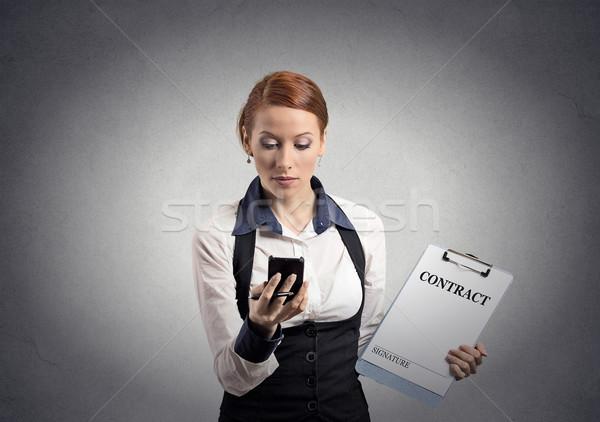 женщину договор документа глядя смартфон Сток-фото © ichiosea