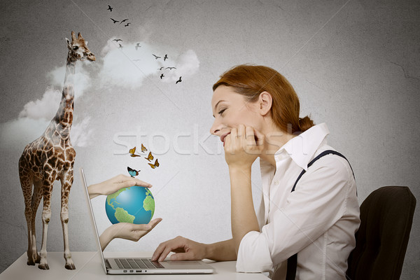 Dreaming woman sitting in front of computer, hands with earth coming from laptop screen Stock photo © ichiosea