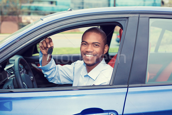 happy, smiling, young man, buyer sitting in his new blue car showing keys Stock photo © ichiosea