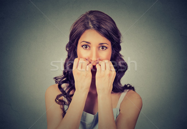 hesitant nervous woman biting her fingernails craving for something or anxious Stock photo © ichiosea