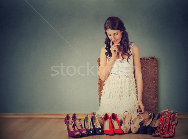 Woman making decisions picking the right pair of high heel shoes  Stock photo © ichiosea