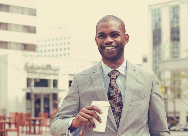 young man with coffee cup smiling Stock photo © ichiosea