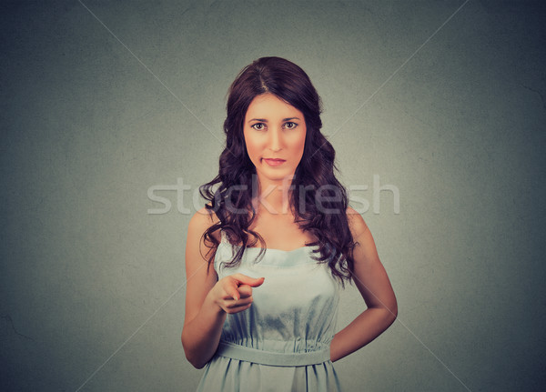 angry displeased young woman pointing at camera  Stock photo © ichiosea