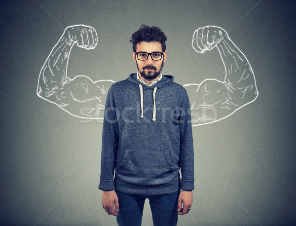 confident strong man hipster on wall background  Stock photo © ichiosea