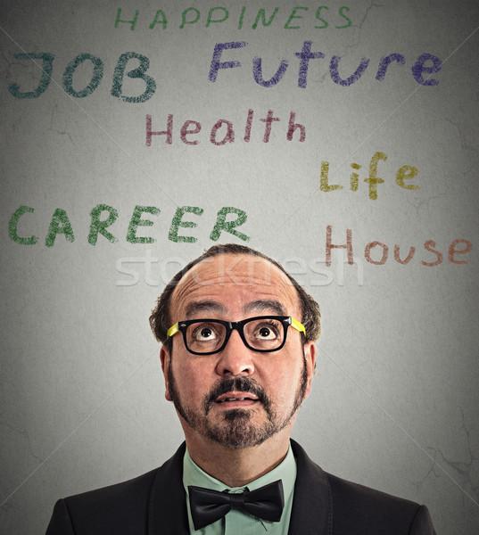 Uomo d'affari occhiali pensare primo piano Foto d'archivio © ichiosea