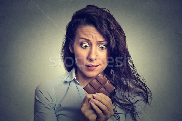 young woman tired of diet restrictions craving sweets chocolate  Stock photo © ichiosea