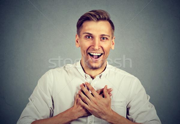 Uomo guardando scioccato sorpreso ridere mani Foto d'archivio © ichiosea