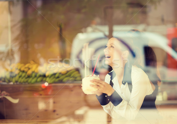 Woman at trendy juice bar coffee shop. Young model enjoying lunch  Stock photo © ichiosea