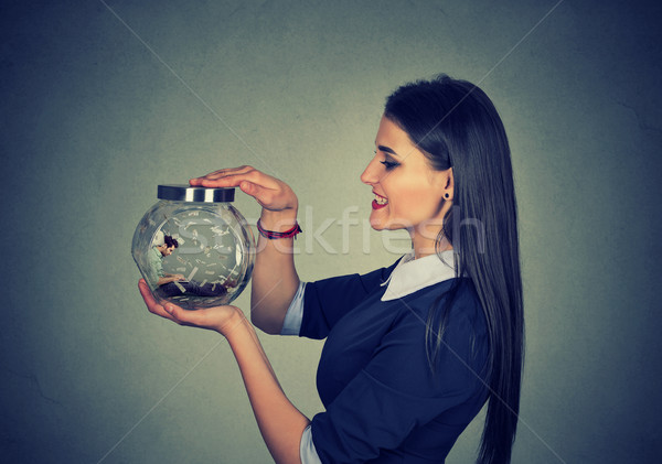 Woman holding a jar with imprisoned man in it  Stock photo © ichiosea