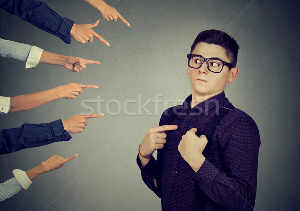 Anxious man judged blamed by people pointing fingers at him Stock photo © ichiosea