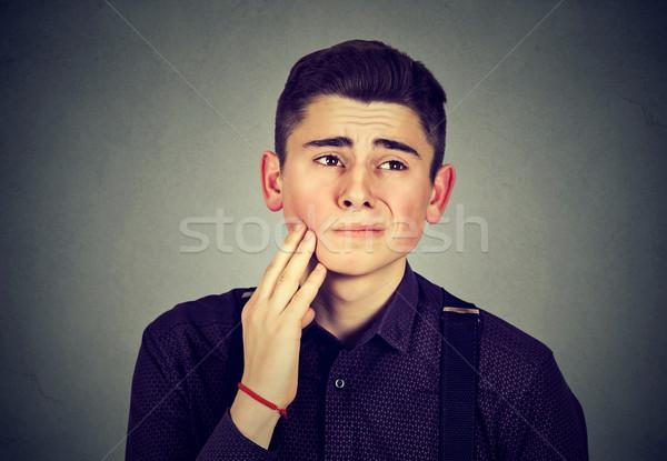 Triste giovane mal di denti faccia uomo salute Foto d'archivio © ichiosea
