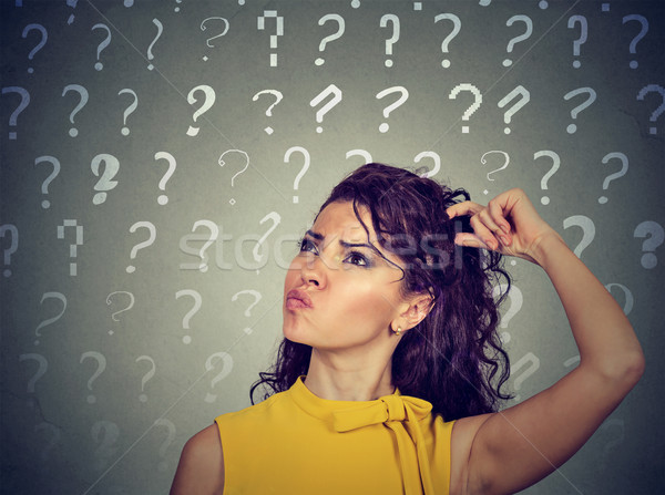 confused thinking woman scratching head has many questions  Stock photo © ichiosea