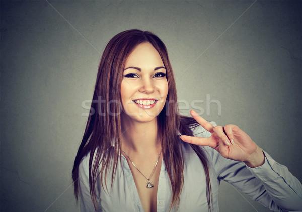 Mulher jovem vitória assinar jovem feliz Foto stock © ichiosea