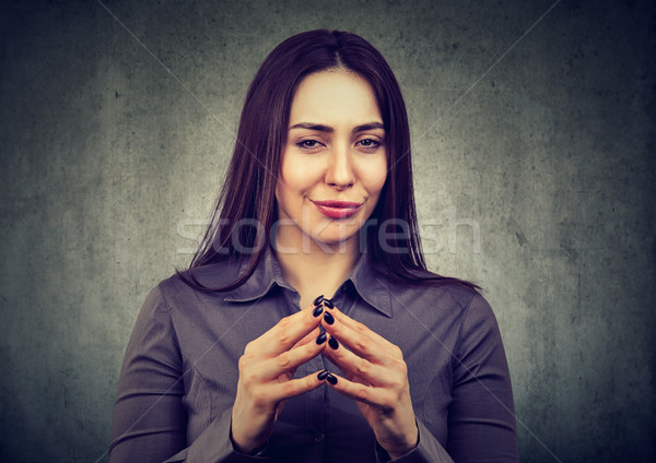 woman looking with sly expression, having good idea Stock photo © ichiosea