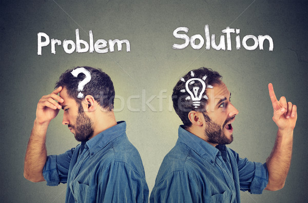 Thoughtful man with question mark has a solution bright idea  Stock photo © ichiosea