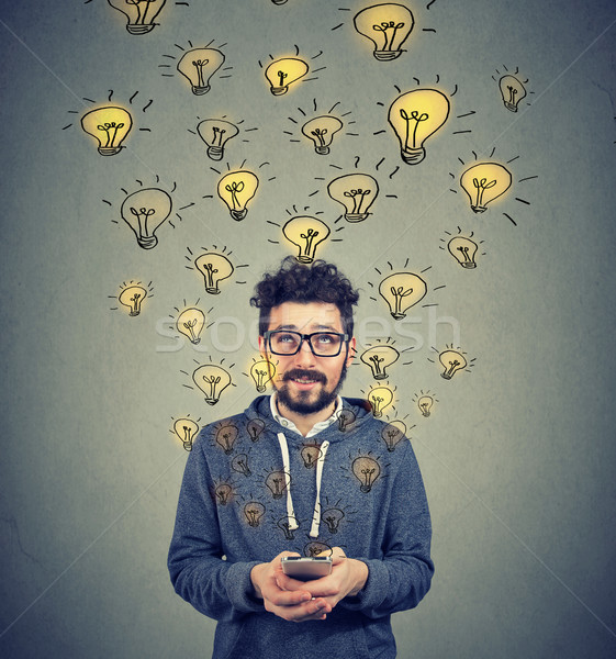 Man with smarpthone developing ideas Stock photo © ichiosea