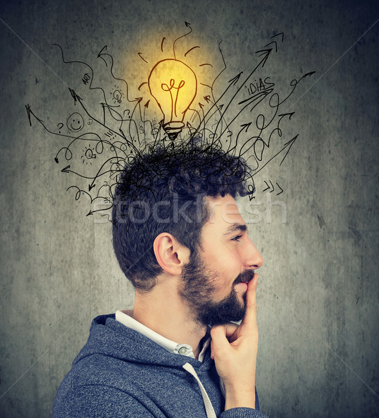 Young happy man has a bright idea  Stock photo © ichiosea