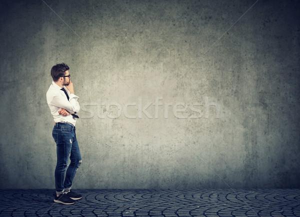 Pensive man looking at empty wall Stock photo © ichiosea