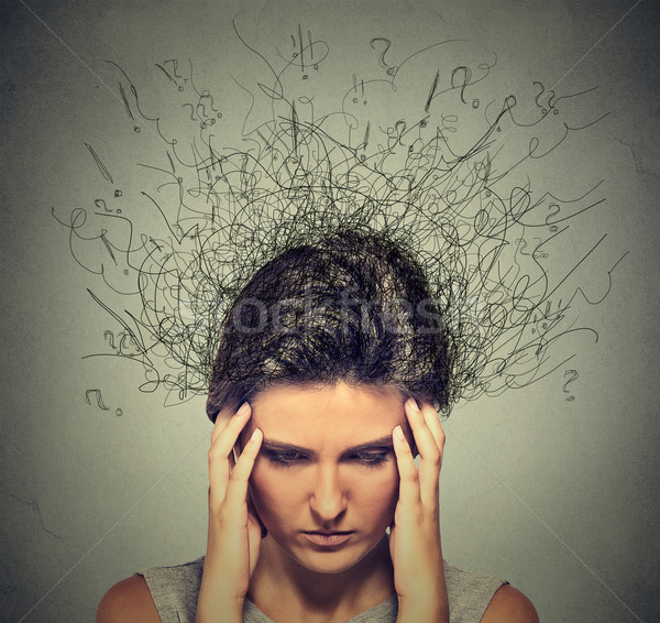 sad young woman with worried stressed face expression and brain melting into lines  Stock photo © ichiosea