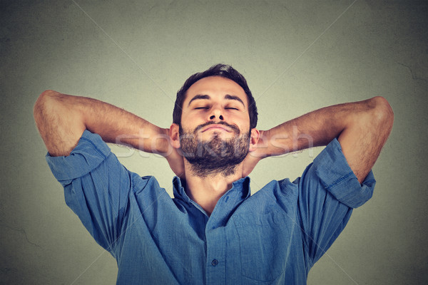 happy young man in blue shirt looking upwards in thought relaxing or napping Stock photo © ichiosea