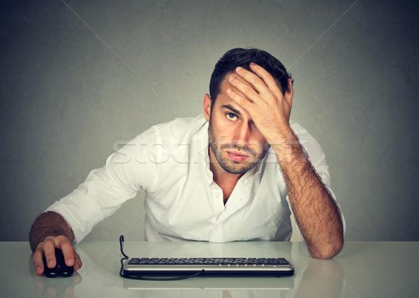 Desperate young man company employee Stock photo © ichiosea