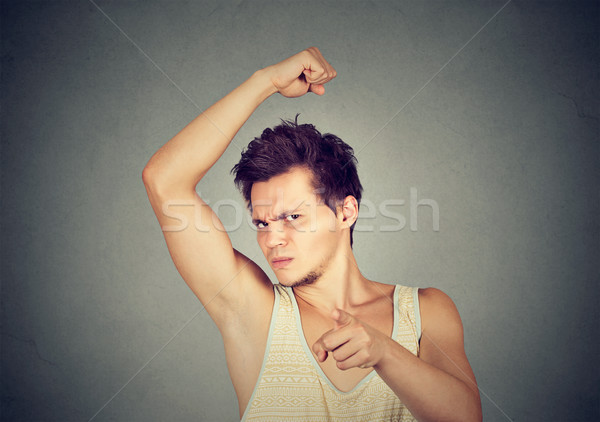man smelling armpit stinks bad odor pointing finger at camera Stock photo © ichiosea