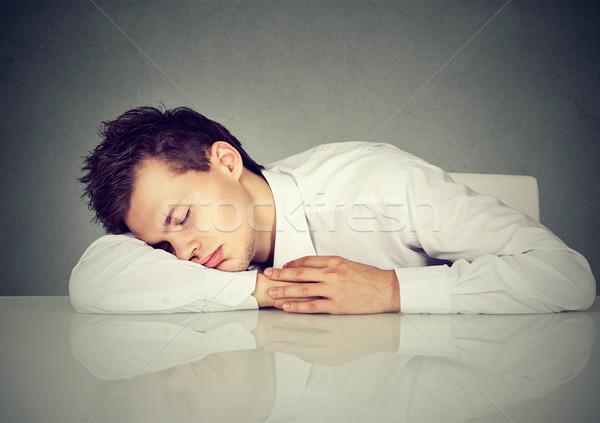 Man sleeping on a desk office table  Stock photo © ichiosea