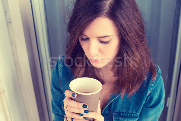 Depressed unhappy young business woman sitting on stairs outdoors with coffee Stock photo © ichiosea