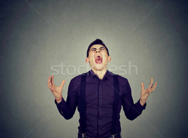 Frustrado desesperado moço gritando homem menino Foto stock © ichiosea
