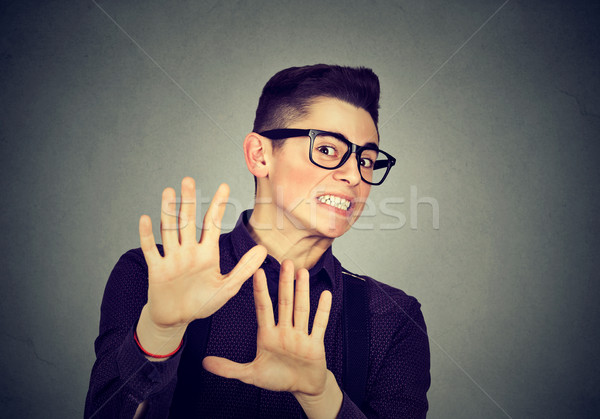 Młody człowiek szary ściany strony twarz człowiek Zdjęcia stock © ichiosea