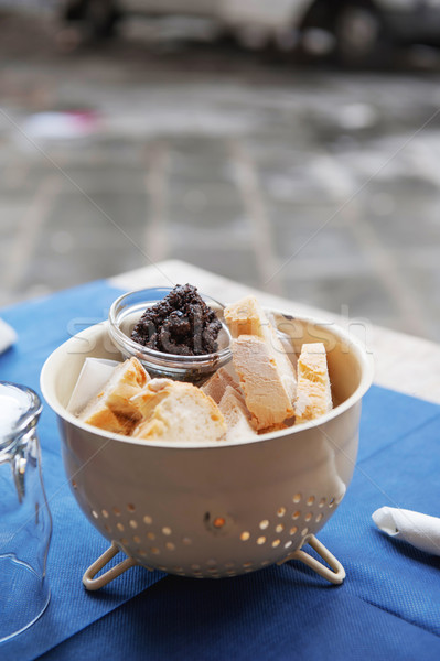 Fresh bread and black olive tapenade Stock photo © ifeelstock