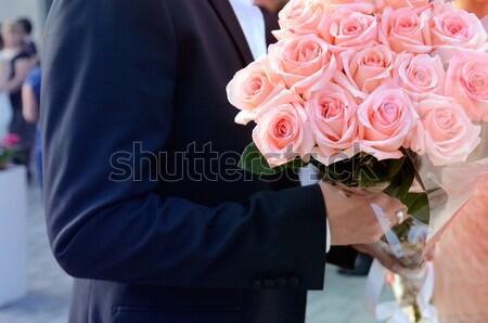 Man holding bouquet in hands Stock photo © ifeelstock