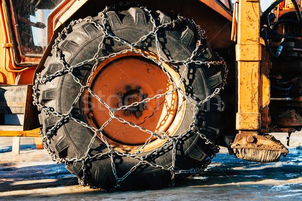 Snow chains on tractor tire Stock photo © ifeelstock