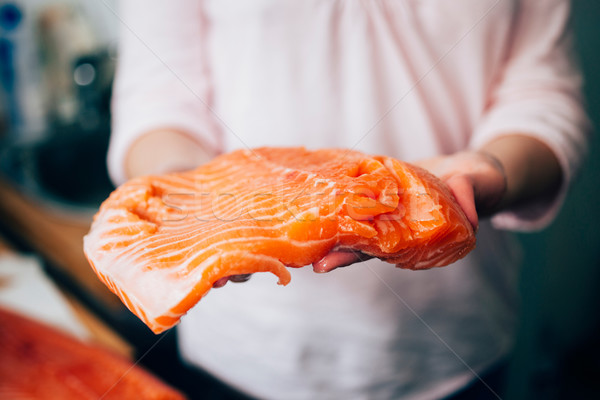 Raw salmon in woman hands Stock photo © ifeelstock