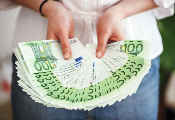 Business woman showing lots of money Stock photo © ifeelstock