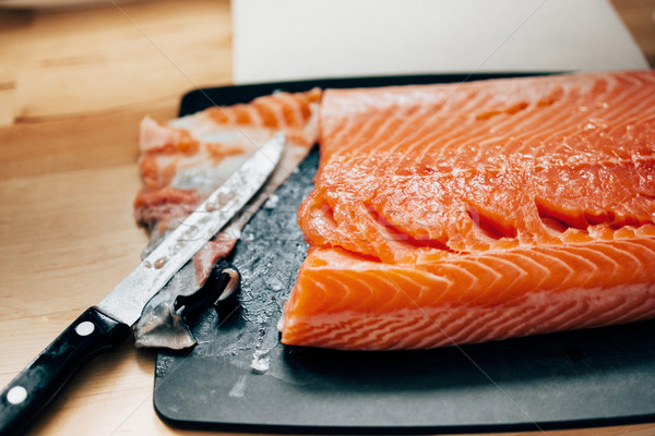 Fresh raw salmon in kitchen Stock photo © ifeelstock