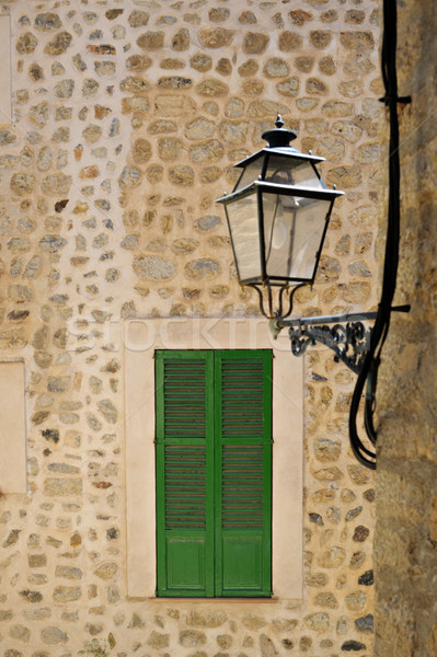 Narrow streets in Palma de Mallorca with typical mediterranean window and stret lamp. Focus is on wi Stock photo © ifeelstock