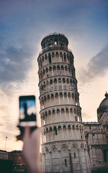 Tourist taking a photo at the Pisa Tower Stock photo © ifeelstock